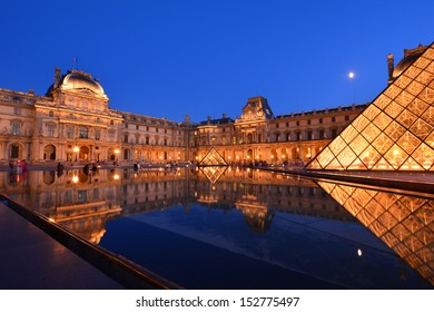 PARIS - AUG 15 : Louvre museum at twilight in summer on August 15,2013. Louvre museum is one of the world's largest museums with more than 8 million visitors each year.