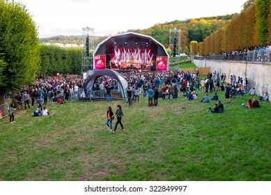 PARIS - AUG 28: Crowd in a concert at Rock En Seine Festival on August 28, 2015 in Paris, France.