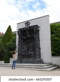 PARIS - AUG 3:  A visitor takes a photograph of the Gates of Hell at the Musee Rodin in Paris, France, is shown here on August 3, 2016.