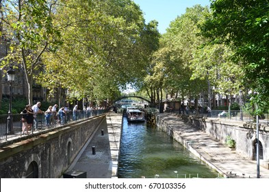 PARIS - AUG 7:  Tourists are shown on a boat ride in the Canal Saint-Martin in Paris, France on August 7, 2016.  It was ordered by Napoleon in 1802 to bring fresh water to Paris.