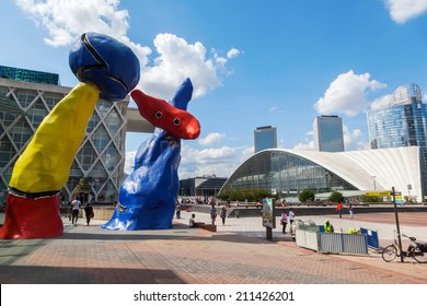 PARIS - AUGUST 05: sculptures of Joan Miro in La Defense with unidentified people on August 05, 2014 in Paris. Its Europes largest business district 72 glass and steel buildings and skyscrapers