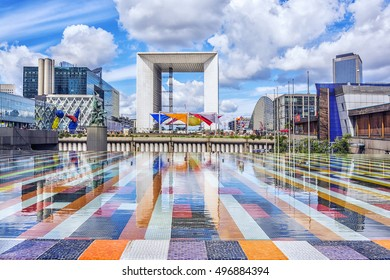 PARIS - AUGUST 20, 2014: Grand Arche, the central building of district La Defense in Paris. It is Europes largest business district with 560 hectares area 72 glass and steel buildings and skyscrapers