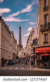 Paris August 2018, peole at the Streets of the city with a look at the eifel tower during a bright summer day, street views Paris France