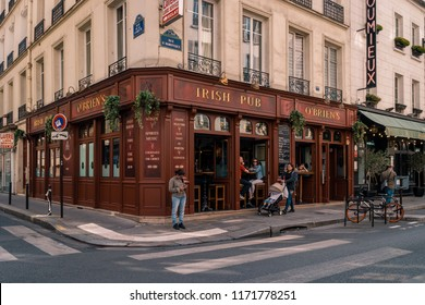 Paris August 2018, people drinking cafe at the terace of an Irish pub in the city