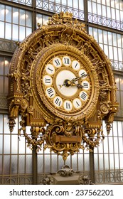 PARIS - AUGUST 21, 2013: Golden clock of the museum D'Orsay in Paris, France. Musee d'Orsay has the largest collection of impressionist and post-impressionist paintings in the world.