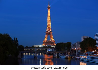 PARIS - AUGUST 27: The illuminated Eiffel Tower on Aug. 27, 2014 in Paris, France.The Eiffel tower is most visited monument of France with 6 million visitors every year