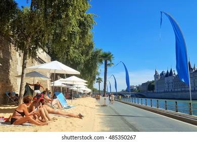 "Paris, August 30th 2016. The ""Paris Plage"" tourist attraction (Paris on the beach) with pedestrian roads near the Seine river"