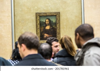 "PARIS - AUGUST 4: Visitors take photo of Leonardo DaVinci's ""Mona Lisa"" at the Louvre Museum, August 4, 2013 in Paris, France. The painting is one of the world's most famous."