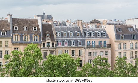 Paris, beautiful buildings in the center, typical parisian facades, panorama with the Saint-Eustache church in background