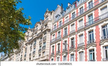 Paris, beautiful pink building boulevard Voltaire, typical parisian facade