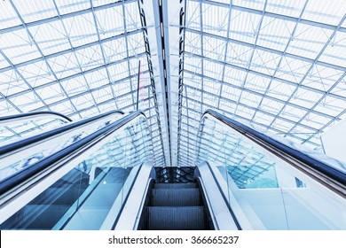 PARIS Charles de Gaulle Airport - 20 JAN 2016. Escalator at the airport PARIS Charles de Gaulle. Colored in blue-gray Technical