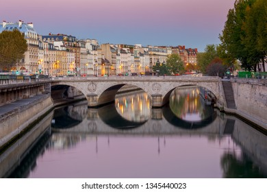 Paris. City embankment at sunrise.