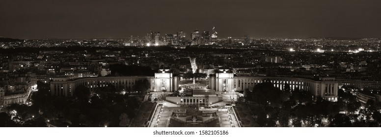 Paris city skyline rooftop view with la Defense at night, France.