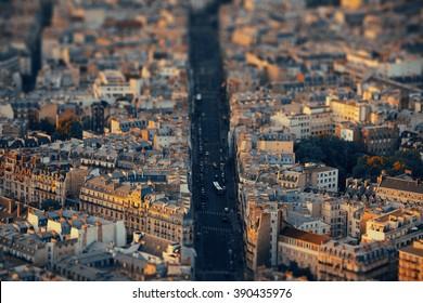 Paris city street rooftop view at sunset tilt-shift effect.