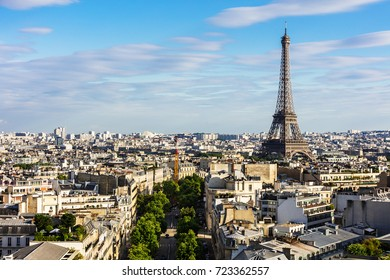 Paris cityscape with Eiffel Tower from the top of Triumphal Arch of the Star (Arc de Triomphe de l'Etoile) at the summer sunset. Paris, France
