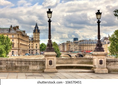 Paris cityscape. View from famous Pont Neuf with traditional lamppost. France.