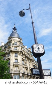 Paris clock and haussmann architecture in bercy boulevard