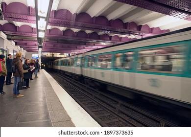 PARIS - DEC 5, 2018 - Metro train in underground station in Paris, France