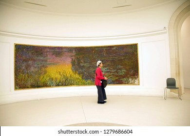 PARIS - DEC 5, 2018 - Visitors view Monet's giant water lily oils in L'Orangerie Museum, Paris, France
