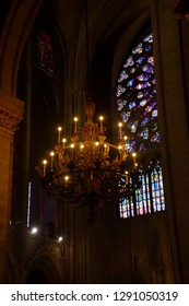 PARIS - DEC 7, 2018 - Chandelier and stained glass in Cathedral of Notre Dame, Paris, France