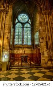 PARIS - DEC 7, 2018 - Gothic vaulting, columns and chandeliers of Cathedral of Notre Dame, Paris, France
