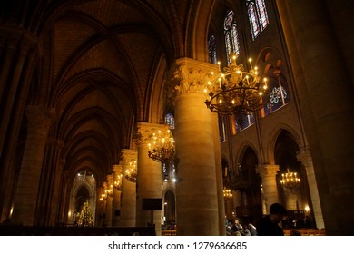 PARIS - DEC 7, 2018 - Gothic vaulting, columns and chandeliers of Cathedral of Notre Dame, Paris, France