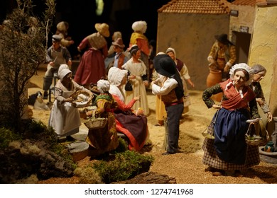 PARIS - DEC 7, 2018 - Village scenes in the Christmas creche of the nativity in the nave of Cathedral of Notre Dame, Paris, France