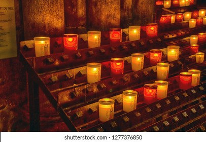 PARIS - DEC 7, 2018 - Votive candles in the Cathedral of Notre Dame, Paris, France