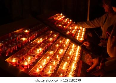 PARIS - DEC 7, 2018 - Votive candles in the Cathedral of Notre Dame, Paris, France