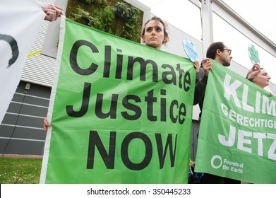 """PARIS - DECEMBER 1: Climate activists at the COP21 UN climate summit in Paris, France, stage a protest calling for """"climate justice now"""", December 1, 2015."""
