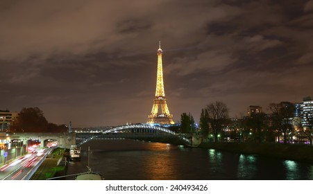 PARIS - DECEMBER 11: The illuminated Eiffel Tower in the night on Dec. 11, 2014 in Paris, France.The Eiffel tower is most visited monument of France with 6 million visitors every year .