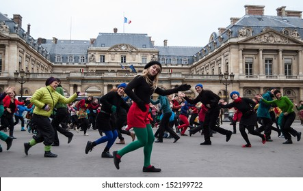 PARIS - DECEMBER 9: People dance at Palais Royal square on December 9, 2012 in Paris, France. This flash mob is held in memory of famous dancer Dominique Bagouet.