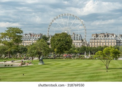 Paris during the summer with a funfair by the Louvre