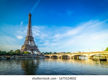 Paris Eiffel Tower reflecting in river Seine with bridge Pont d'Iena in Paris, France. Eiffel Tower is one of the most iconic landmarks of Paris., toned