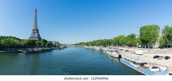 Paris Eiffel Tower and river Seine at summer in Paris, France. Eiffel Tower is one of the most iconic landmarks of Paris.