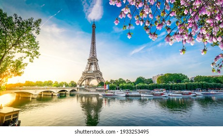 Paris Eiffel Tower and river Seine with sunrise in Paris, France. Eiffel Tower is one of the most iconic landmarks of Paris, web banner format ar early spring morning
