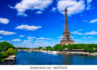 Paris Eiffel Tower and river Seine in Paris, France. Eiffel Tower is one of the most iconic landmarks of Paris. Architecture and landmarks of Paris