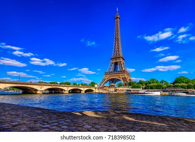 Paris Eiffel Tower and river Seine in Paris, France. Eiffel Tower is one of the most iconic landmarks of Paris. Architecture and landmarks of Paris.