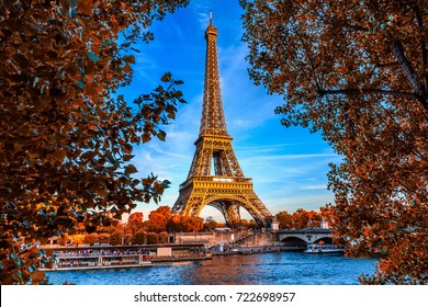 Paris Eiffel Tower and river Seine in Paris, France. Eiffel Tower is one of the most iconic landmarks of Paris. Autumn Paris.