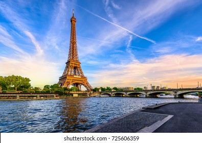 Paris Eiffel Tower and river Seine at sunset in Paris, France. Eiffel Tower is one of the most iconic landmarks of Paris. Postcard of Paris - Shutterstock ID 725606359