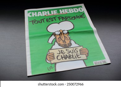 PARIS - FEBRUARY 05, 2015: The cover of latest edition of Charlie Hebdo, which shows the prophet Muhammad weeping by Luz. It was produced by staff members who survived the attack against their office.