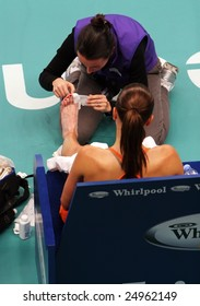 PARIS - FEBRUARY 13: Serbia's Jelena Jankovic receives medical help during quarter finals at Open GDF SUEZ WTA tournament, Pierre de Coubertin stadium on February 13, 2009 in Paris, France.
