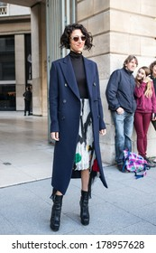 PARIS - FEBRUARY 26, 2014: Stylish European woman with sunglasses, blue coat at the Place Vendome. Paris Fashion Week: Ready to Wear 2014/2015 is held in Paris from February 25 to March 5, 2014.
