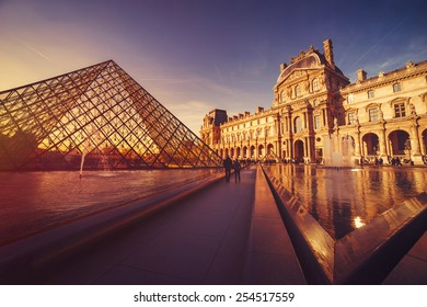 PARIS - FEBRUARY 7, 2015: Louvre Museum at sunset on February 7, 2015 in Paris. The Louvre Museum is one of the world's largest museums, a historic monument and a central landmark of Paris.