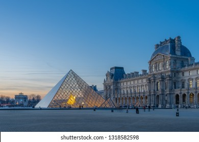Paris, France - 02 17 2019: The Pyramid and the buildings of the Louvre Museum at sunset