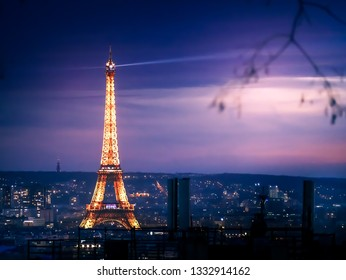 Paris, France - 02/03/2019 -  Illuminated Eiffel Tower at night from Montmartre