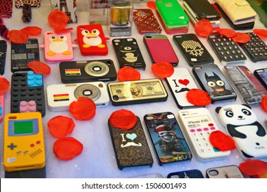 Paris, France -02-14-2014: Old covers and cases for mobile phones for sale in a display window