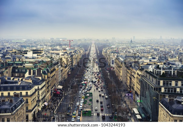 Paris, France - 02192018 : Champs Elysees avenue, polluted sky.