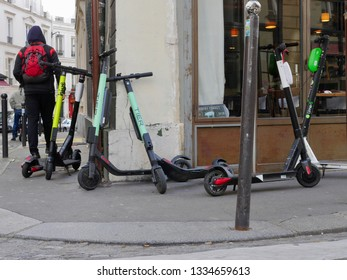 Paris, France - 03/10/2019 : In the streets of Montmartre, self-service electric scooters park everywhere on the sidewalks obstructing the passage of pedestrians
