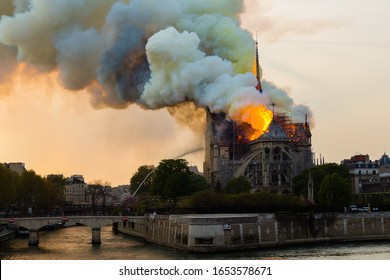 """Paris/ France - 04-15-2019 The fire of the roof of the Notre Dame. The photo is taken from the """"post de la Tournelle""""/ turret bridge"""